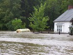 A propane tank floats by a house on Taylor Road. Photo by Peter Wood.