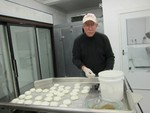 Inside the new creamery, Dan Jones shapes the goat feta cheese into patties.