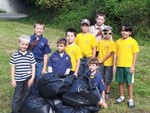 Photo by Arlene Roberts. Cub Scouts from Pack 20 clean up park.