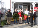 Photo by Jim Lennon. Cornwall Lions Club members Ed Moulton(left) along with Monique Summerfield and Bill Rubnitz (right) are pictured with three customers who had just purchased holiday wreaths at the Cornwall Lions Annual Holiday Sale on Main Street in Cornwall.