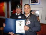 Photo by Jim Lennon. E5 Ortiz, with his father Rafael, holds American Legion Award at Painters on Friday January 02.