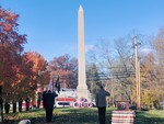 Photo by Casey Regenbaum. Salute the Memorial after the wreaths were placed.